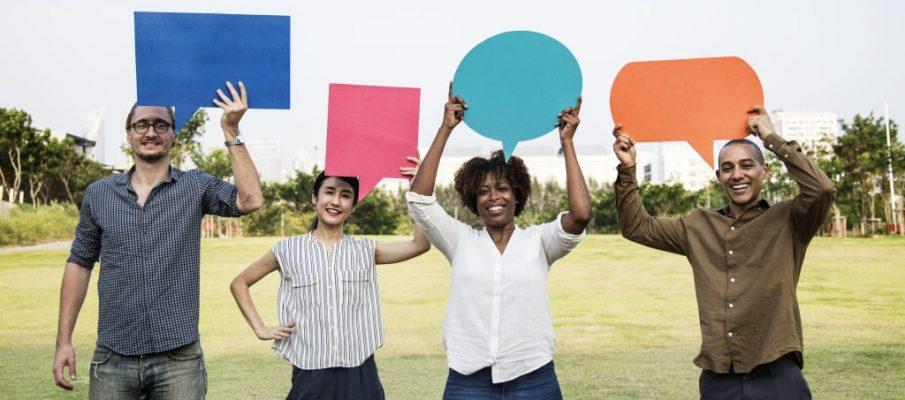 Diverse friends holding speech bubbles